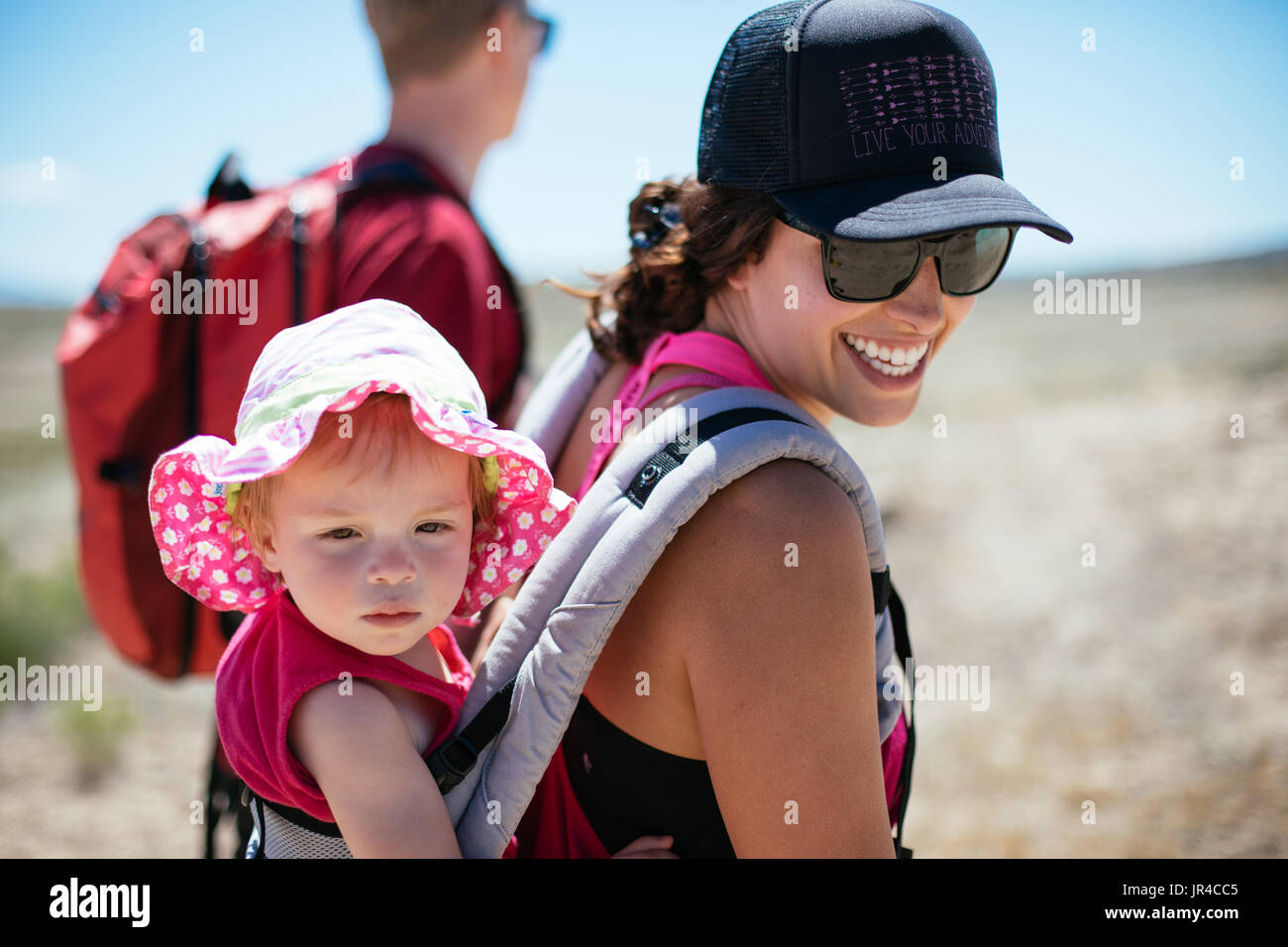 Mother, father, and toddler on a fun desert hike - Stock Image