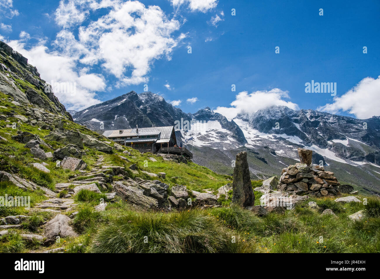 Trekking in the Zillertal seen here with Kasseler Hut mountain refuge. Stock Photo