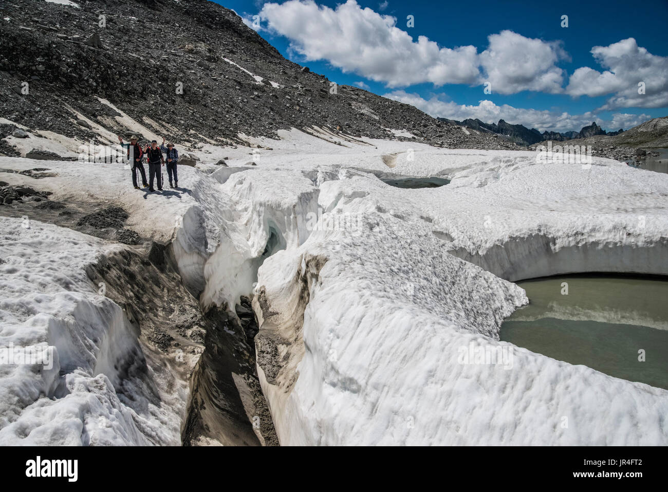 Trekking in the Zillertal seen here with mountaineers on ice remnants of the Stillupp Kees glacier Stock Photo