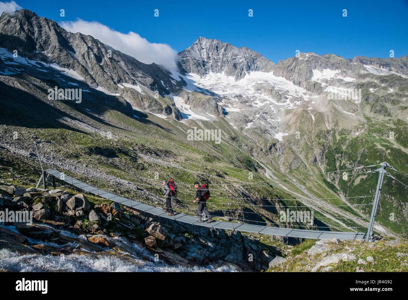 Trekking in the Zillertal seen here with mountaineers en-route between the Greizer and Kasseler Hut mountain refuge Stock Photo