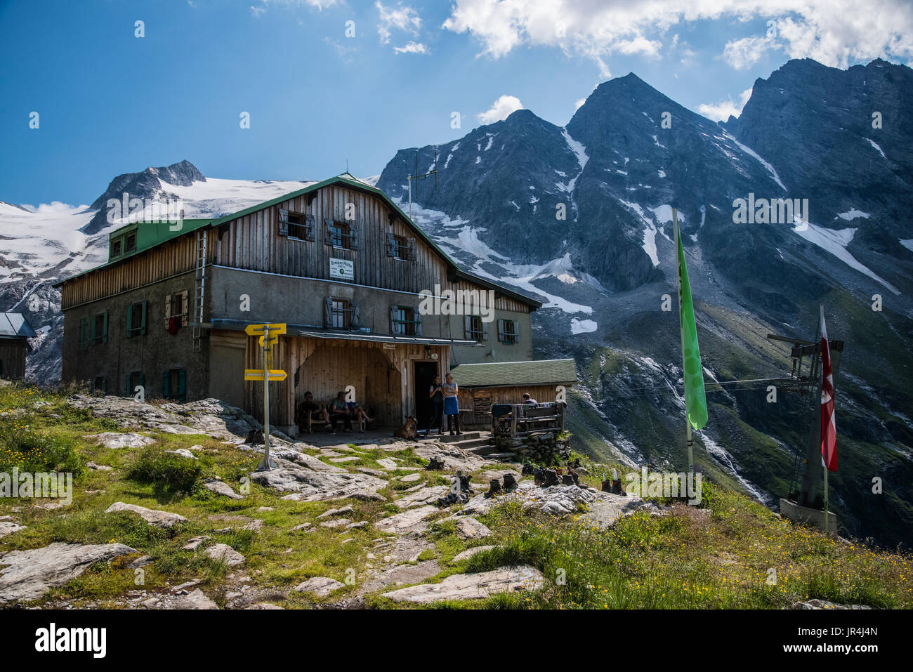Trekking in the Zillertal seen here with the Greizer Hut mountain refuge Stock Photo
