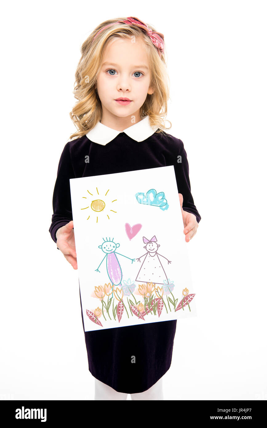 Small kid with paintings - Stock Image