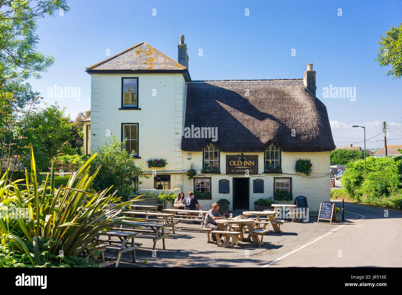 Old village pub in Mullion village, Cornwall, West country, England, UK in summer with beer garden - Stock Image