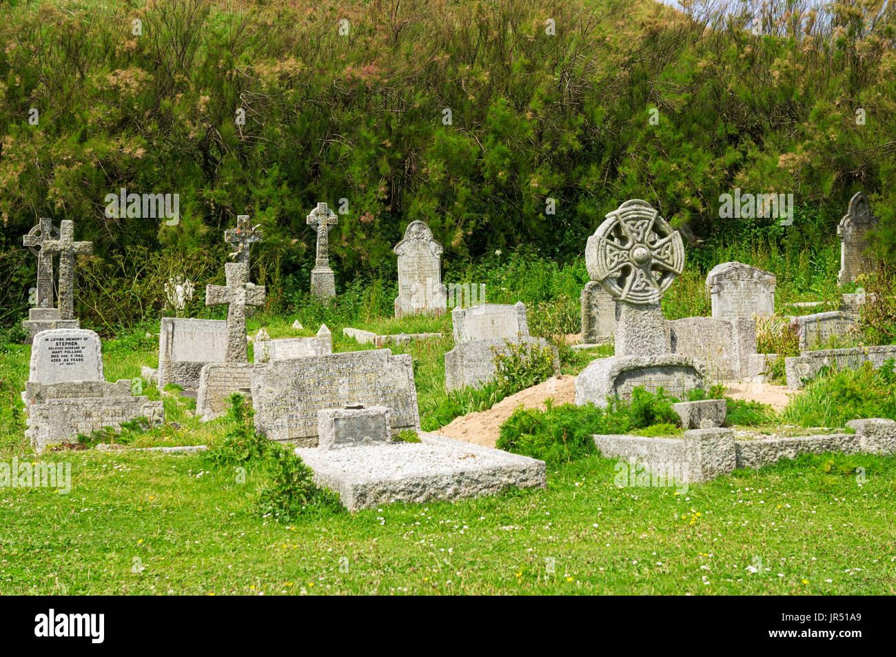 Old gravestones in a churchyard, UK - Stock Image