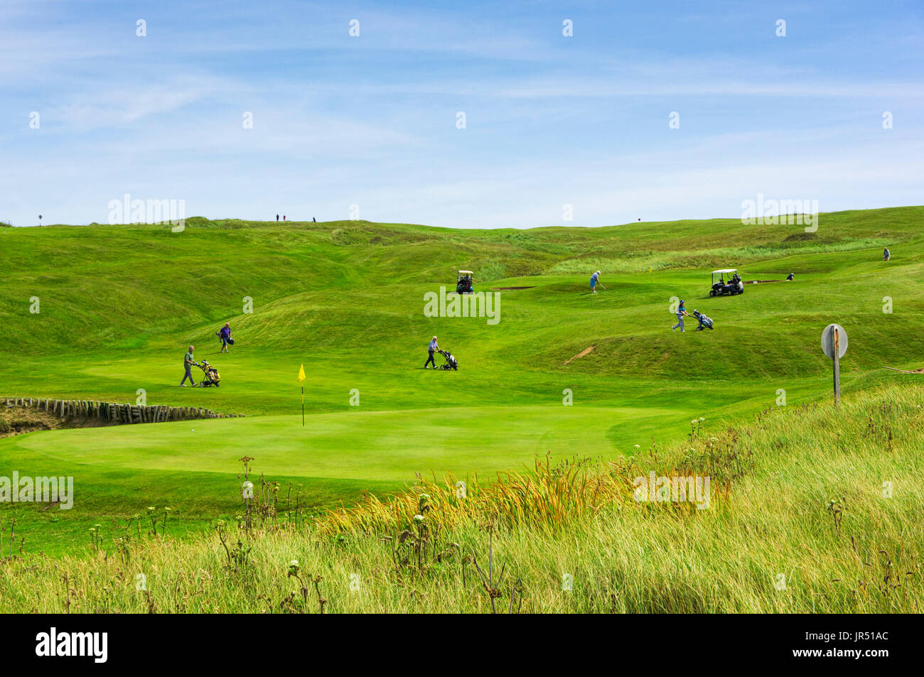 Golfers on a Links golf course on the coast, England, UK - Stock Image