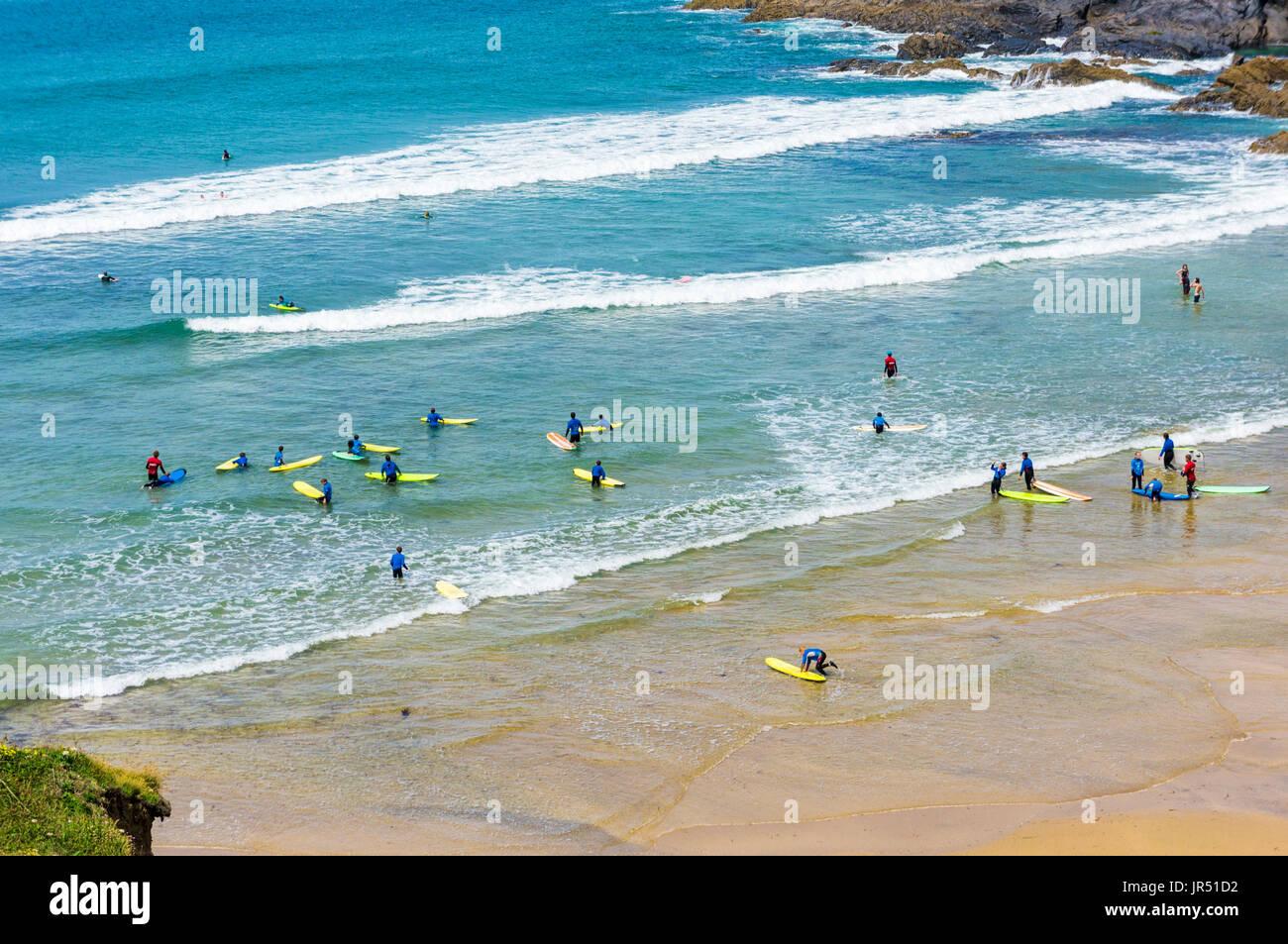 Surfing school at Poldhu Cove beach, Lizard Peninsula, Cornwall, UK - Stock Image