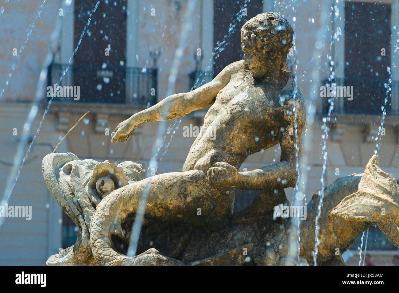 Sicily piazza, detail of a mythological figure in the Artemis Fountain in the Piazza Archimede, Ortigia Island, Syracuse (Siracusa) Sicily. - Stock Image