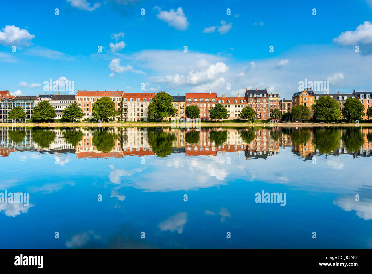 Houses along river in Downtown District of Copenhagen Denmark - Stock Image