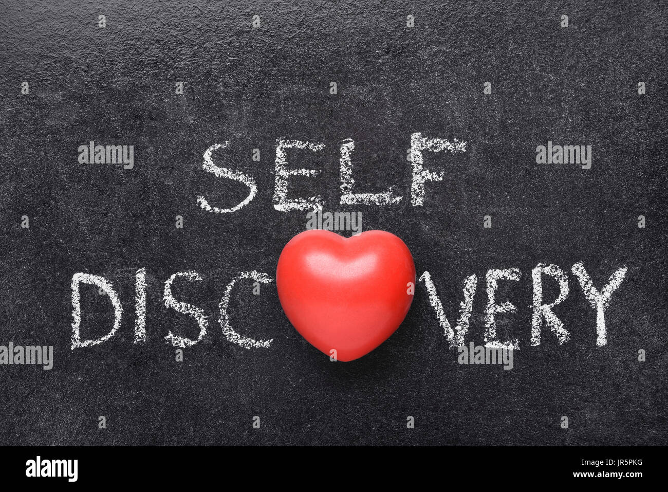 self discovery heart phrase handwritten on blackboard with heart symbol instead of O Stock Photo