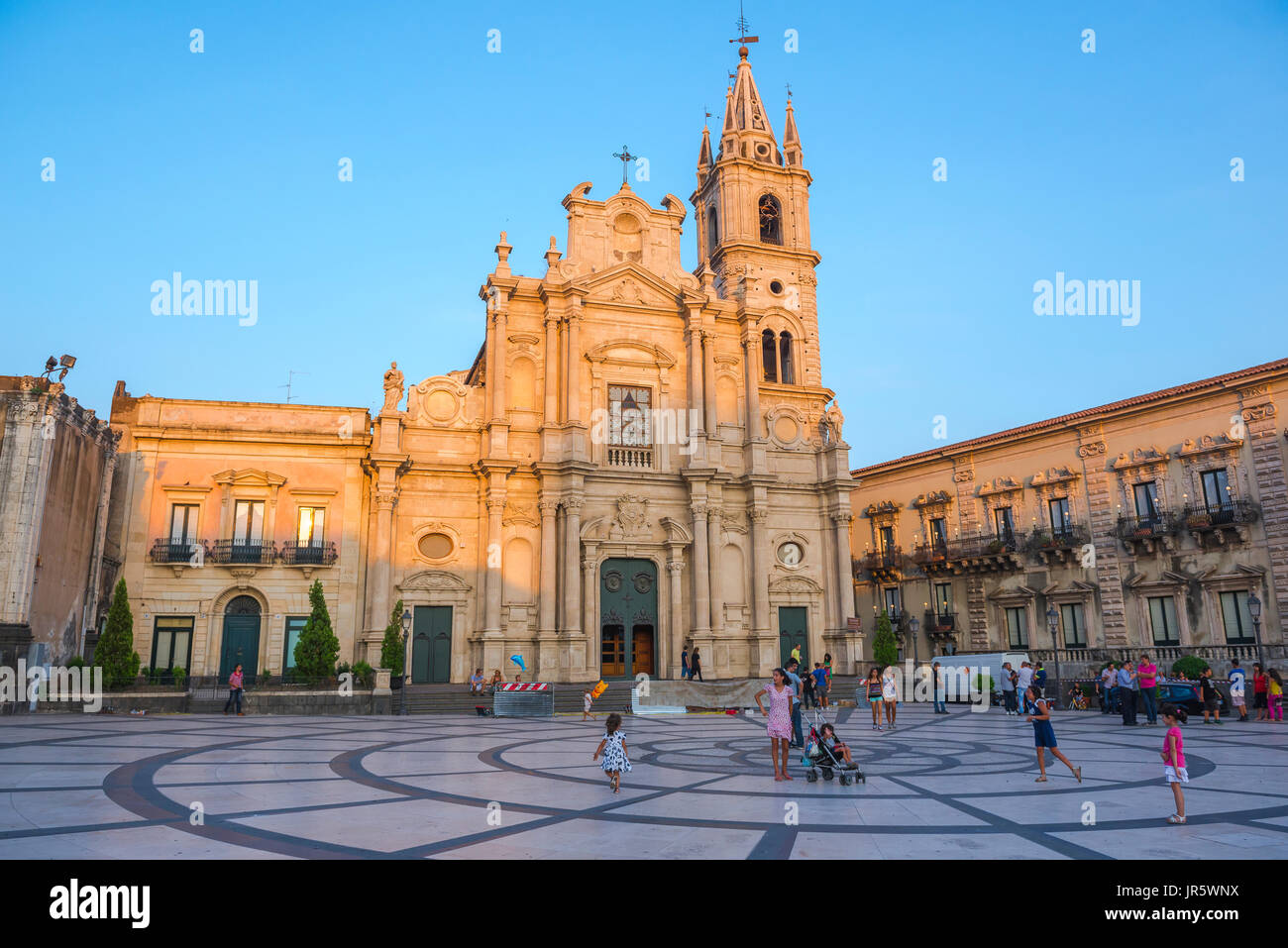 Sicily piazza children, children at play in the Piazza Duomo in Acireale, near Catania, Sicily. - Stock Image