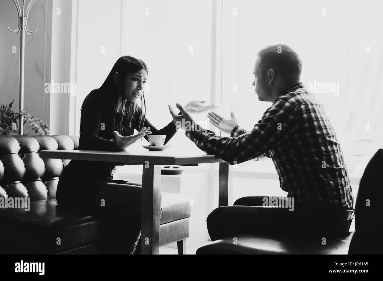 Man and woman in discussions in the restaurant - Stock Image