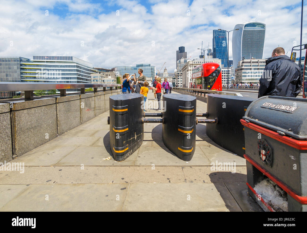 Anti-vehicle barriers erected on the pavement on London Bridge in the Borough area, Southwark, London SE1 as a terrorism Stock Photo