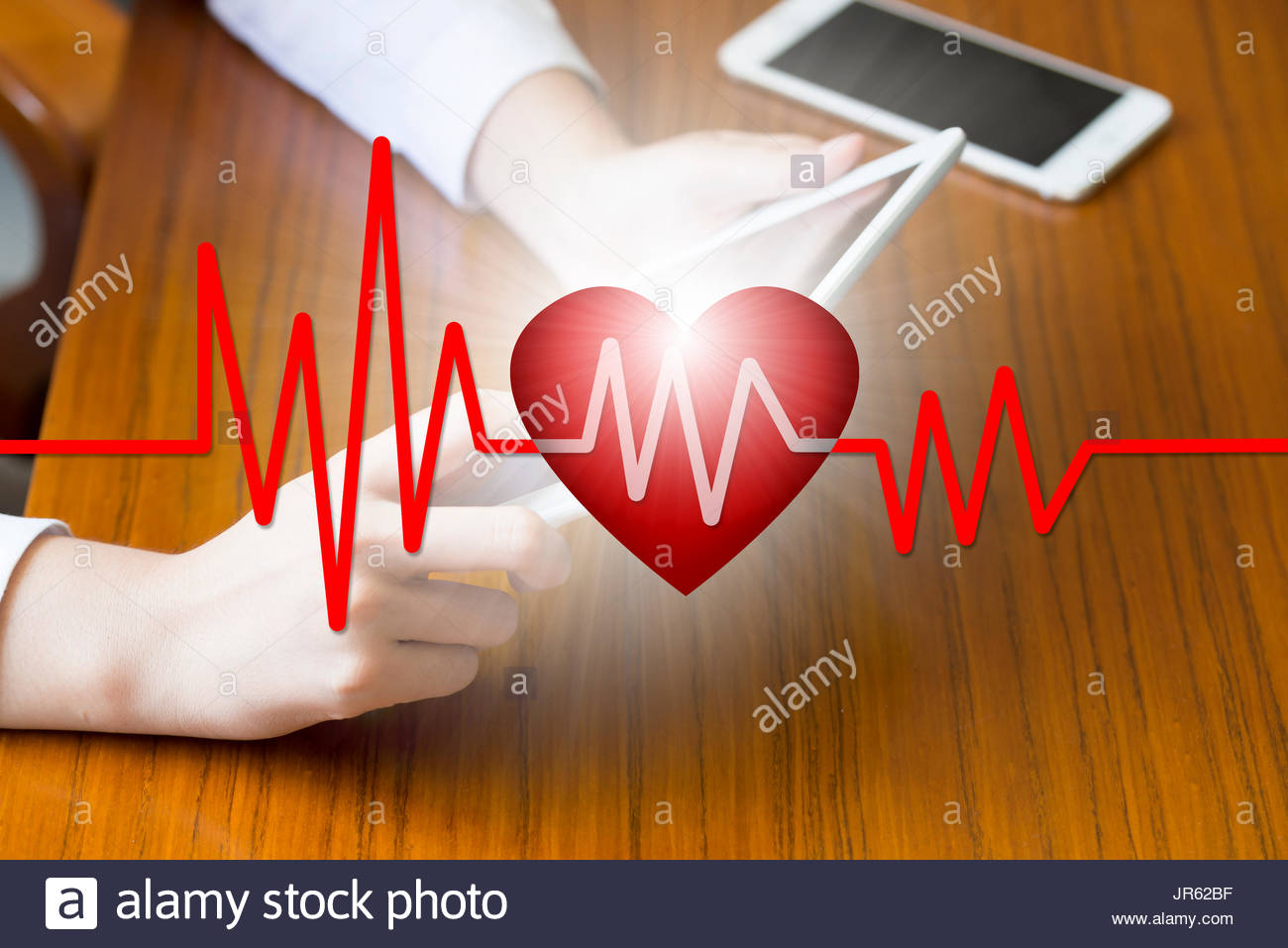 Doctors press tablet, iPad, E-Health concept, health, medicine and heArt and artwork disease concept, health care business philosophy - Stock Image