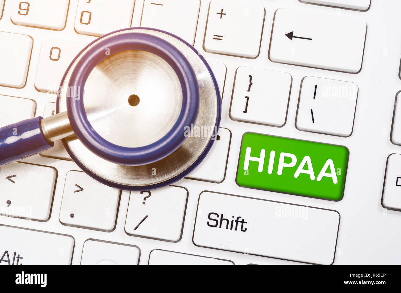 Health Insurance Portability and Accountability Concept - Stethoscope with written HIPPA on coumputer keyboard. - Stock Image