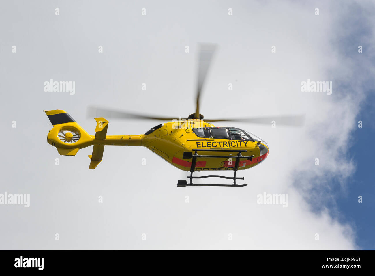 EUROCOPTER DEUTSCHLAND GMBH helicopter, registered G-WPDD, flying low as it surveys power lines for Western Power - Stock Image