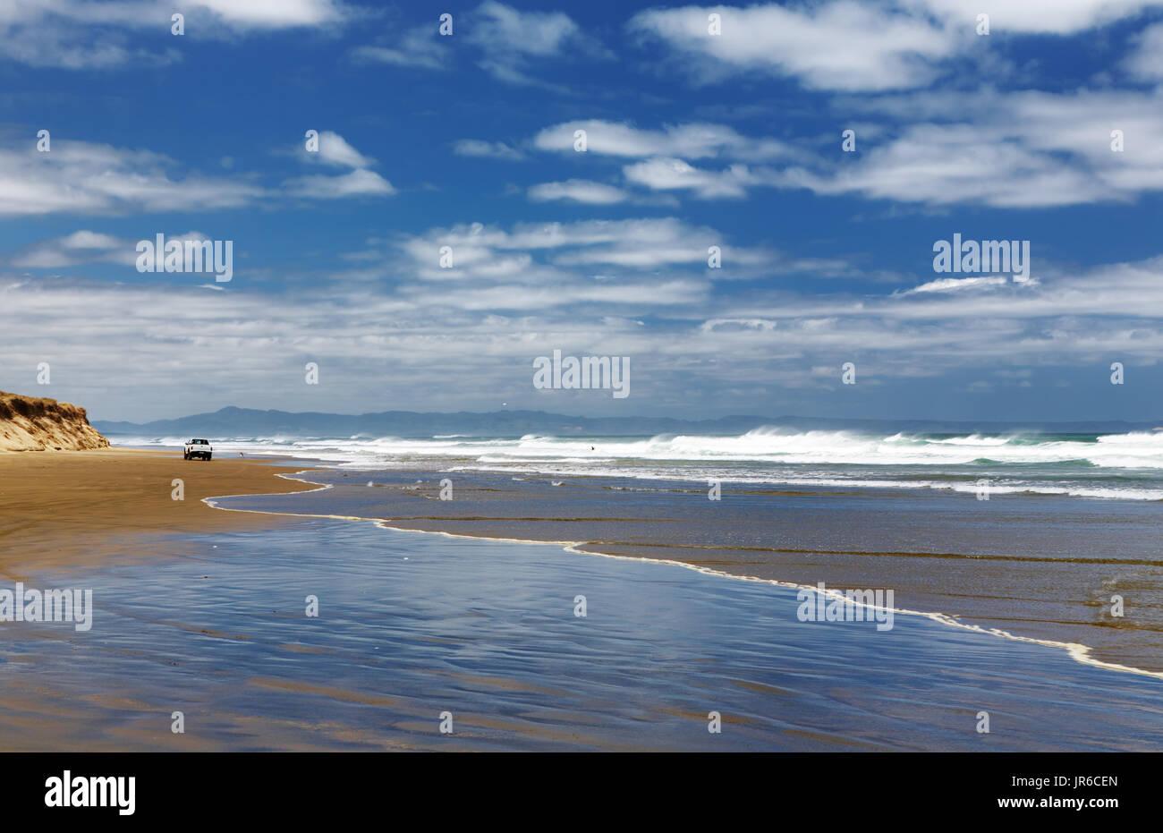 Car on the beach, Ninety Mile Beach, New Zealand Stock Photo