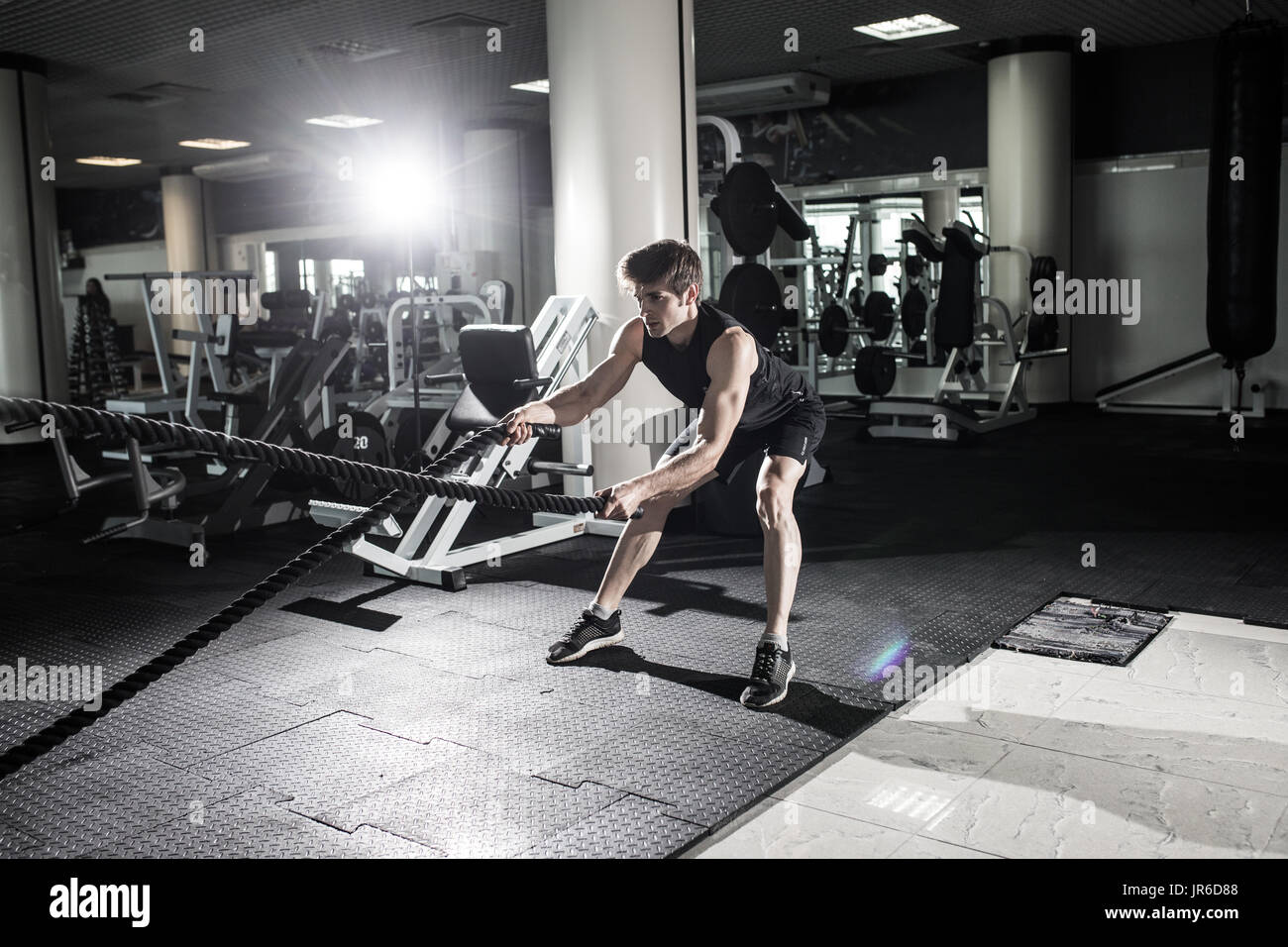 Battle ropes exercise in the gym. Crossfit - Stock Image