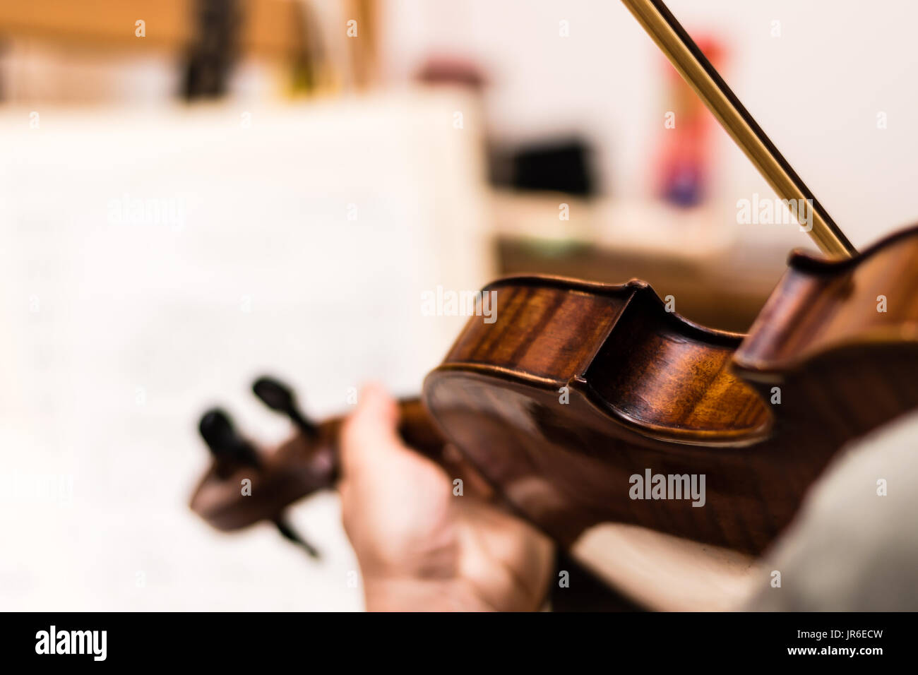 Musician playing the brown violin. Shallow depth of field. - Stock Image