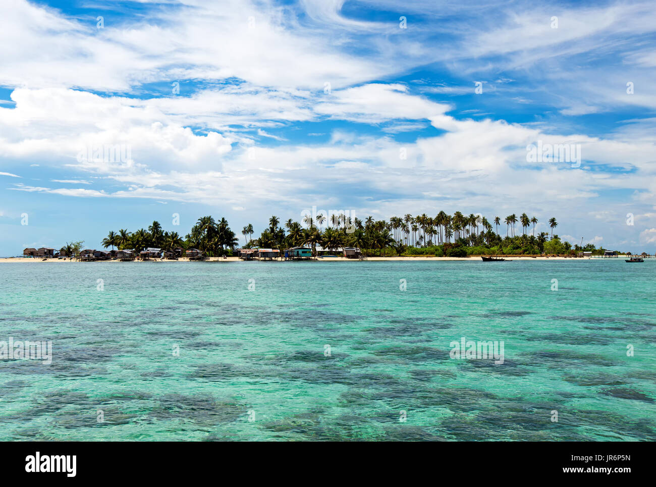 Beautiful clear and turquoise colored water near Maiga Island located in Semporna in the vicinity of Sipidan Island and Tun Sakaran Marine Park, Sabah - Stock Image
