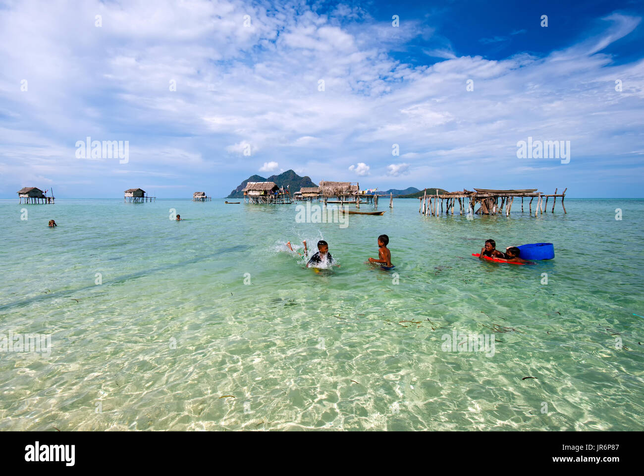 Semporna, Malaysia - April 17, 2015: Young bajau laut  boys playing at the beach in Maiga Island in the vicinity of Sipidan Island and Tun Sakaran Mar - Stock Image
