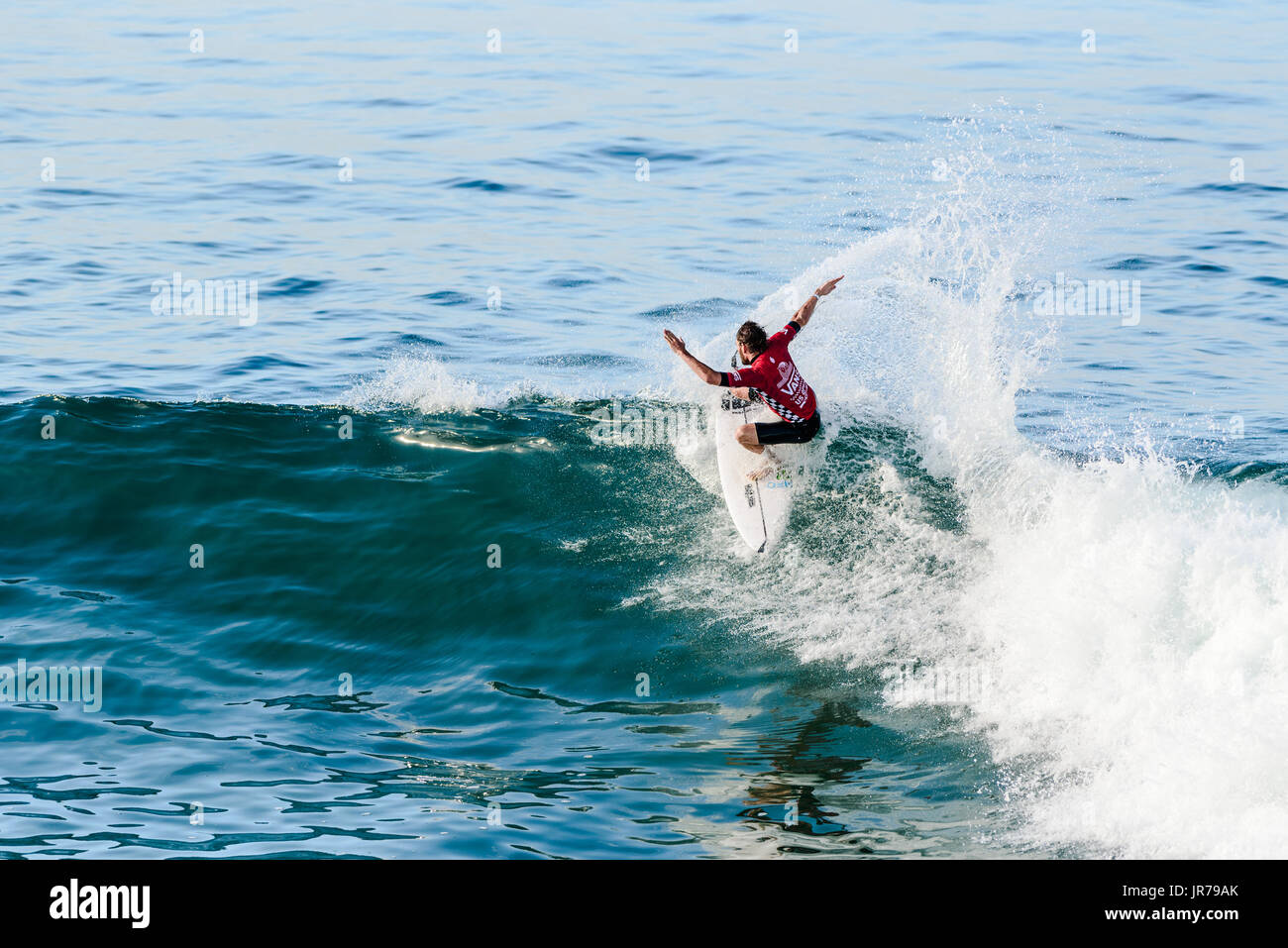 Huntington Beach, USA. 03 August, 2017. Frederico Morals (PRT) competes at the 2017 VANS US Open of Surfing. Credit: Benjamin Ginsberg/Alamy Live News. - Stock Image