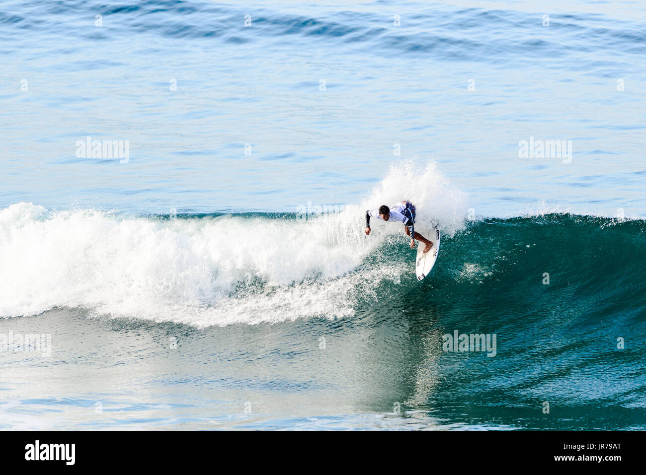 Huntington Beach, USA. 03 August, 2017. Josh Moniz (USA-Hawaii) wins his round 2 heat with a blend of big, progressive airs and classic turns at the 2017 VANS US Open of Surfing. Credit: Benjamin Ginsberg/Alamy Live News. - Stock Image