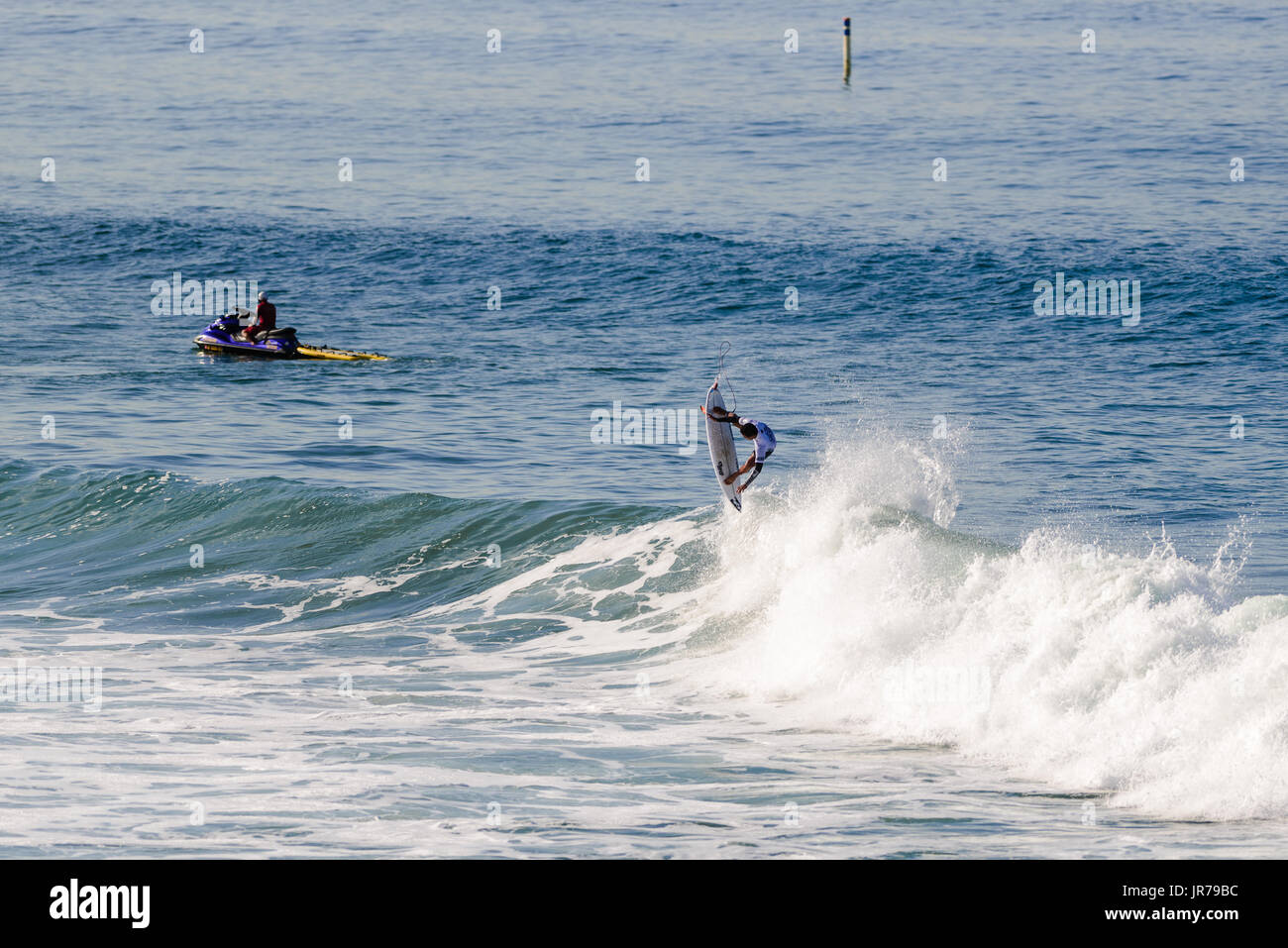Huntington Beach, USA. 03 August, 2017. Surfer Josh Moniz launches one of multiple airs which seem him through round 2 and into round 3 at the 2017 VANS US Open of Surfing. Credit: Benjamin Ginsberg/Alamy Live News. - Stock Image