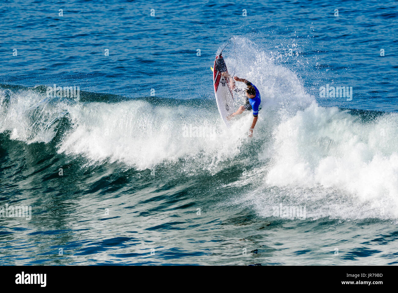 Huntington Beach, USA. 03 August, 2017. Local hero and two-time event winner Brett Simpson (USA) airs over a closeout section at the 2017 VANS US Open of Surfing. Credit: Benjamin Ginsberg/Alamy Live News. - Stock Image