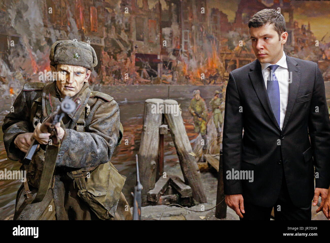 Kaliningrad Region, Russia. 3rd Aug, 2017. The acting governor of Kaliningrad Region, Anton ALikhanov (R), views a 3-dimensional panoramic exhibition titled 'Konigsberg 1945: the Final Assault' at the Kaliningrad Region Museum of History and Arts; the 360-degree display, which depicts the April 1945 assault by the Red Army on the city of Konigsberg in WWII, is an artwork by the Nevsky Batalist team led by Dmitry Poshtarenko. Credit: Vitaly Nevar/TASS/Alamy Live News - Stock Image