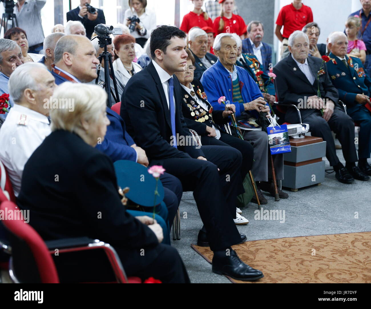 Kaliningrad Region, Russia. 3rd Aug, 2017. WWII veterans and the acting governor of Kaliningrad Region, Anton ALikhanov (C), visit a 3-dimensional panoramic exhibition titled 'Konigsberg 1945: the Final Assault' at the Kaliningrad Region Museum of History and Arts; the 360-degree display, which depicts the April 1945 assault by the Red Army on the city of Konigsberg in WWII, is an artwork by the Nevsky Batalist team led by Dmitry Poshtarenko. Credit: Vitaly Nevar/TASS/Alamy Live News - Stock Image