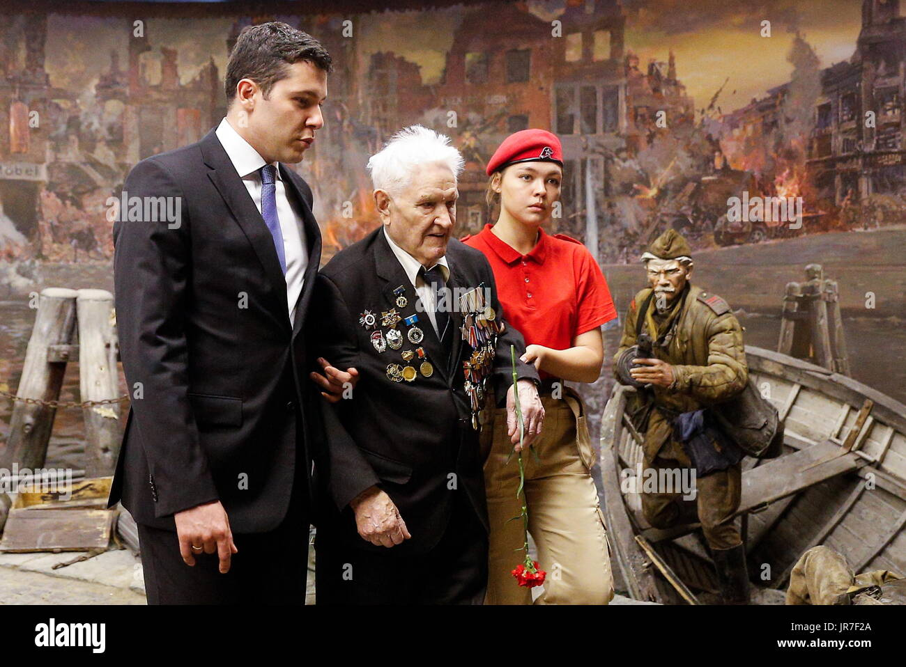 Kaliningrad Region, Russia. 3rd Aug, 2017. The acting governor of Kaliningrad Region, Anton Alikhanov (L), and war veteran Ivan Tikhonov (C) who took part in the final assault on Konigsberg in 1945, view a 3-dimensional panoramic exhibition titled 'Konigsberg 1945: the Final Assault' at the Kaliningrad Region Museum of History and Arts; the 360-degree display, which depicts the April 1945 assault by the Red Army on the city of Konigsberg in WWII, is an artwork by the Nevsky Batalist team led by Dmitry Poshtarenko. Credit: Vitaly Nevar/TASS/Alamy Live News - Stock Image