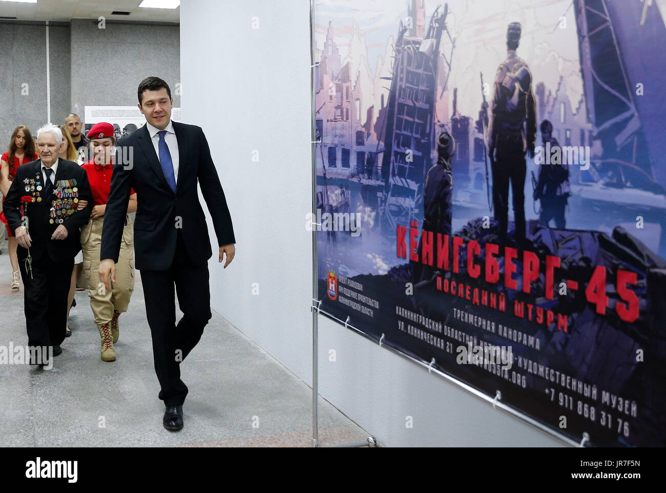 Kaliningrad Region, Russia. 3rd Aug, 2017. War veteran Ivan Tikhonov (L) who took part in the final assault on Konigsberg in 1945, and the acting governor of Kaliningrad Region, Anton Alikhanov (front), visit a 3-dimensional panoramic exhibition titled 'Konigsberg 1945: the Final Assault' at the Kaliningrad Region Museum of History and Arts; the 360-degree display, which depicts the April 1945 assault by the Red Army on the city of Konigsberg in WWII, is an artwork by the Nevsky Batalist team led by Dmitry Poshtarenko. Credit: Vitaly Nevar/TASS/Alamy Live News - Stock Image