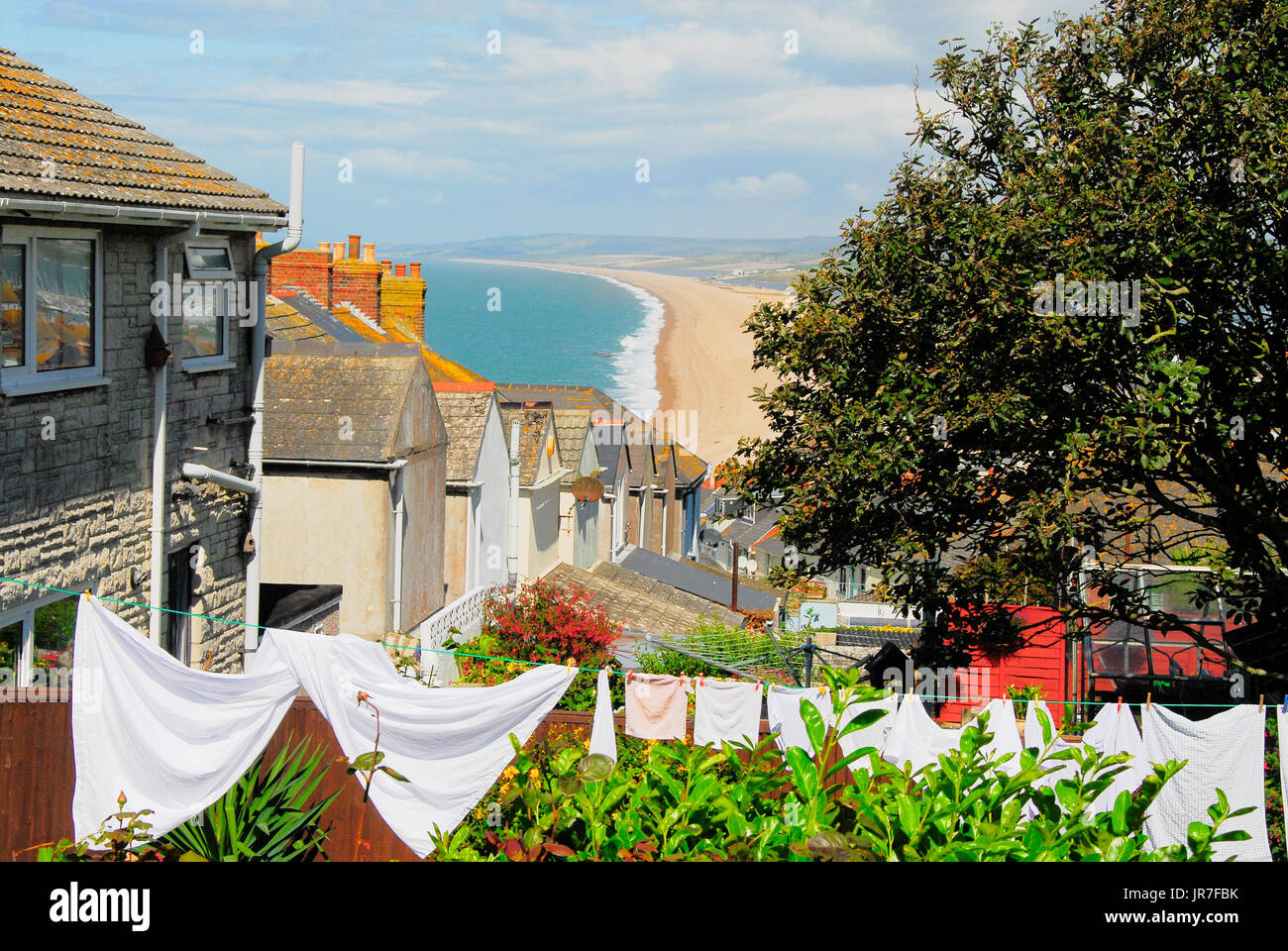 Chesil Beach, Dorset. 04th Aug, 2017. UK Weather: Washing dries in a sunny Fortuneswell garden on a breezy & bright day in Dorset Credit: stuart fretwell/Alamy Live News - Stock Image