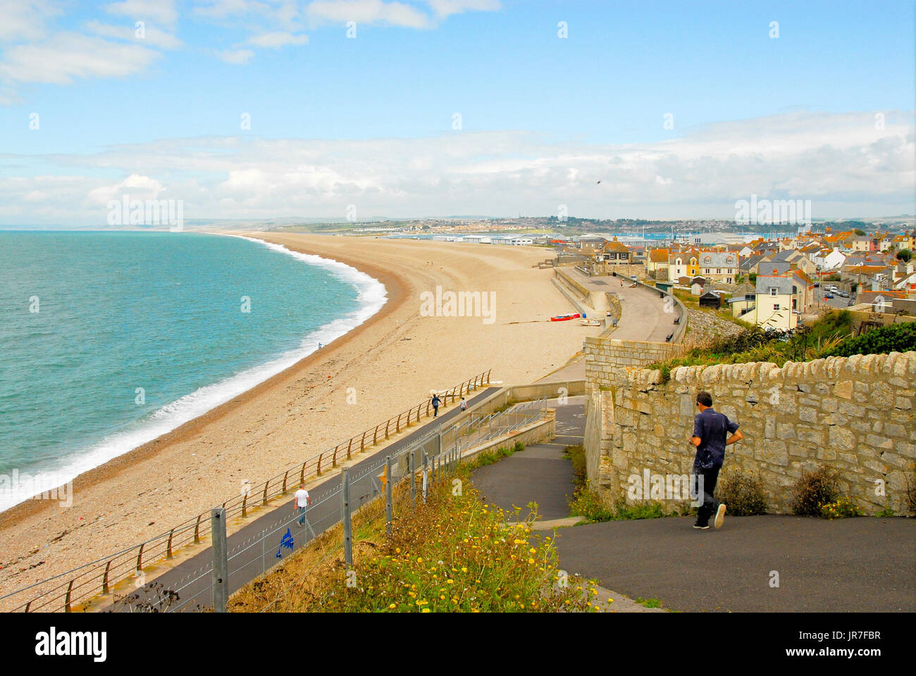 Chesil Beach, Dorset. 04th Aug, 2017. UK Weather: A man hurries down to his fishing boat on a bright and breezy day along Chesil Beach Credit: stuart fretwell/Alamy Live News - Stock Image