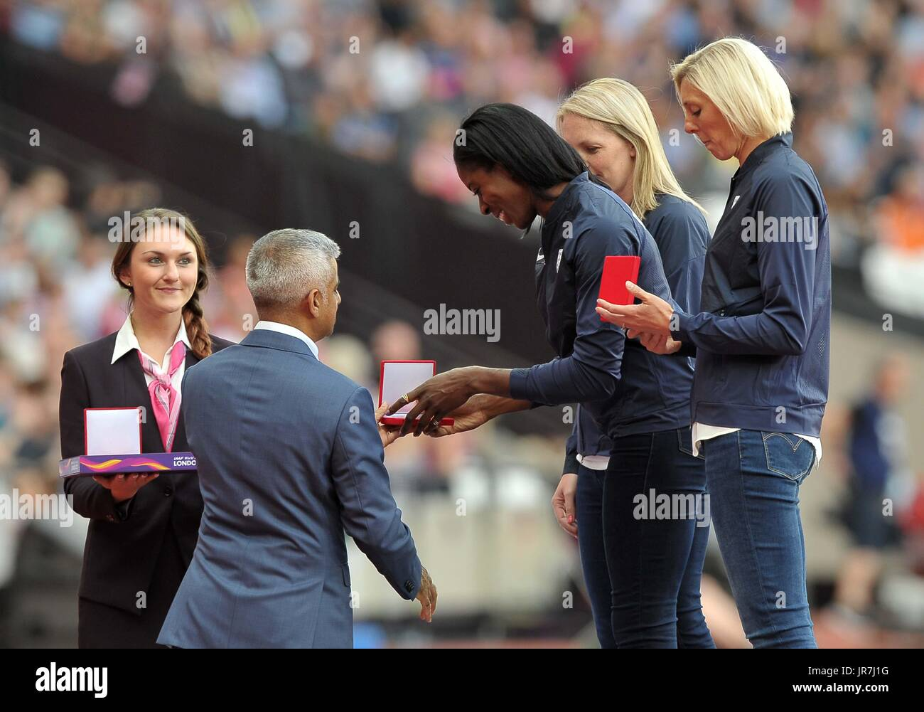 Christine Ohuruogu recieves her Bronze medal for the IAAF world championships in Berlin 2009 from Mayor of London Sadiq Khan. IAAF World athletics championships. London Olympic stadium. Queen Elizabeth Olympic park. Stratford. London. UK. 04/08/2017. - Stock Image