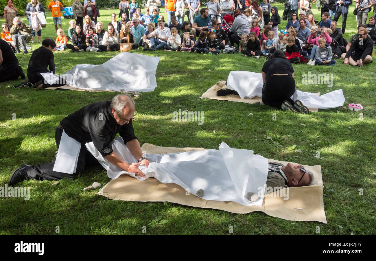 Stockton on Tees, England, UK. 4th Aug, 2017. UK Weather: Bright and breezy for the first day of the 30th Sockton International Riverside festival. PIctured: Massager by South Korean artists CCOT. 'Paper massages are given to audience members creating 'paper humans' whose susceptibility to wind, water and fire reminds us of the fragility of life'. Credit: ALAN DAWSON/Alamy Live News - Stock Image
