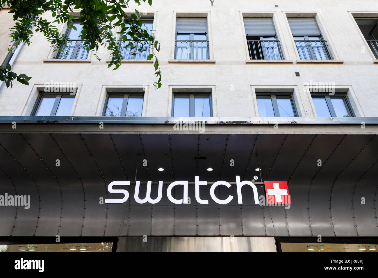 GENEVA, SWITZERLAND - JUNE 19, 2017: Swatch logo on the main store of the brand in Geneva. Swatch is one of the most famous watch manufacturers in Swi - Stock Image