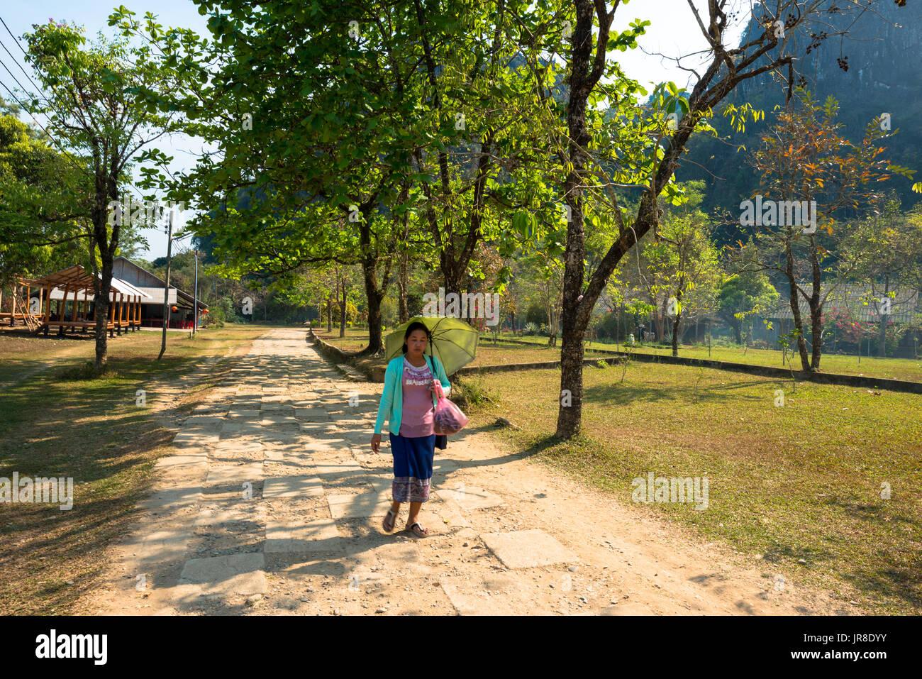 VANG VIENG, LAOS - MARCH 14, 2017: Local Lao woman walking