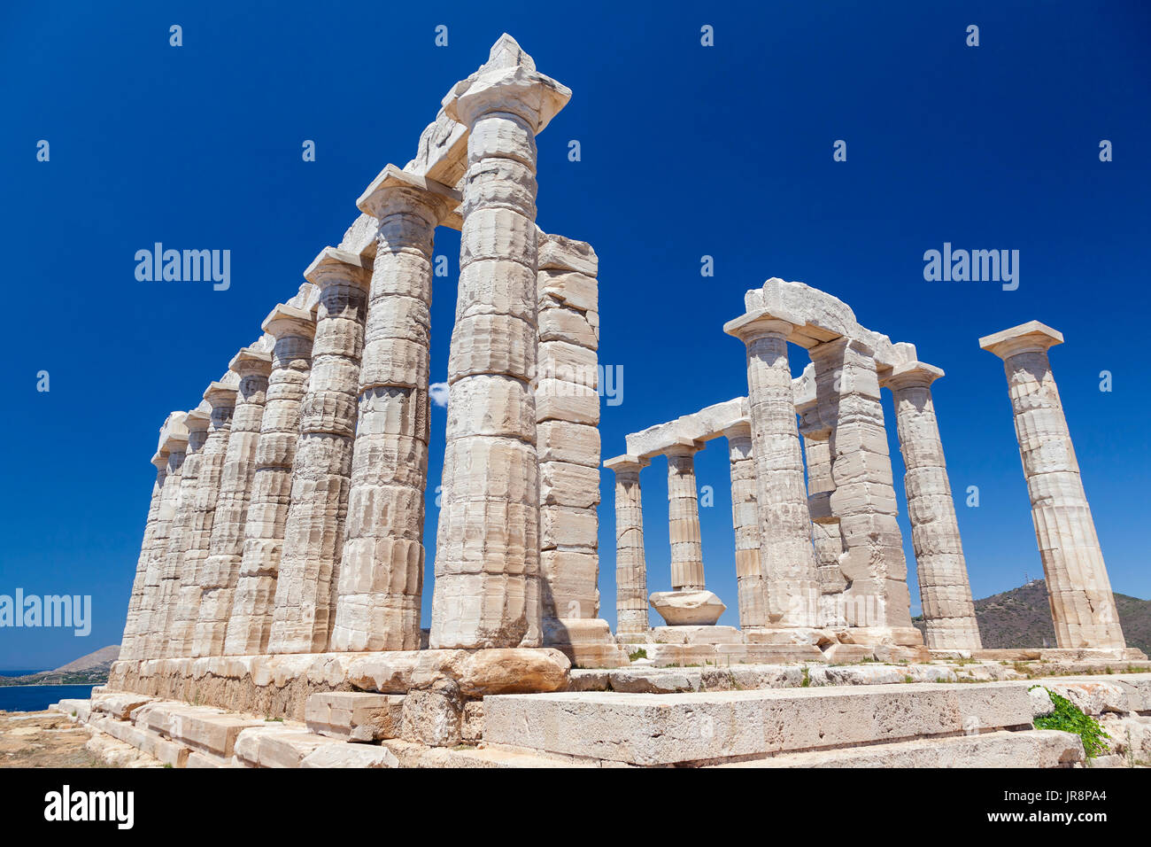 The temple of Poseidon, in Sounion cape, on of the most emblematic and popular archaeological sites in Greece. - Stock Image