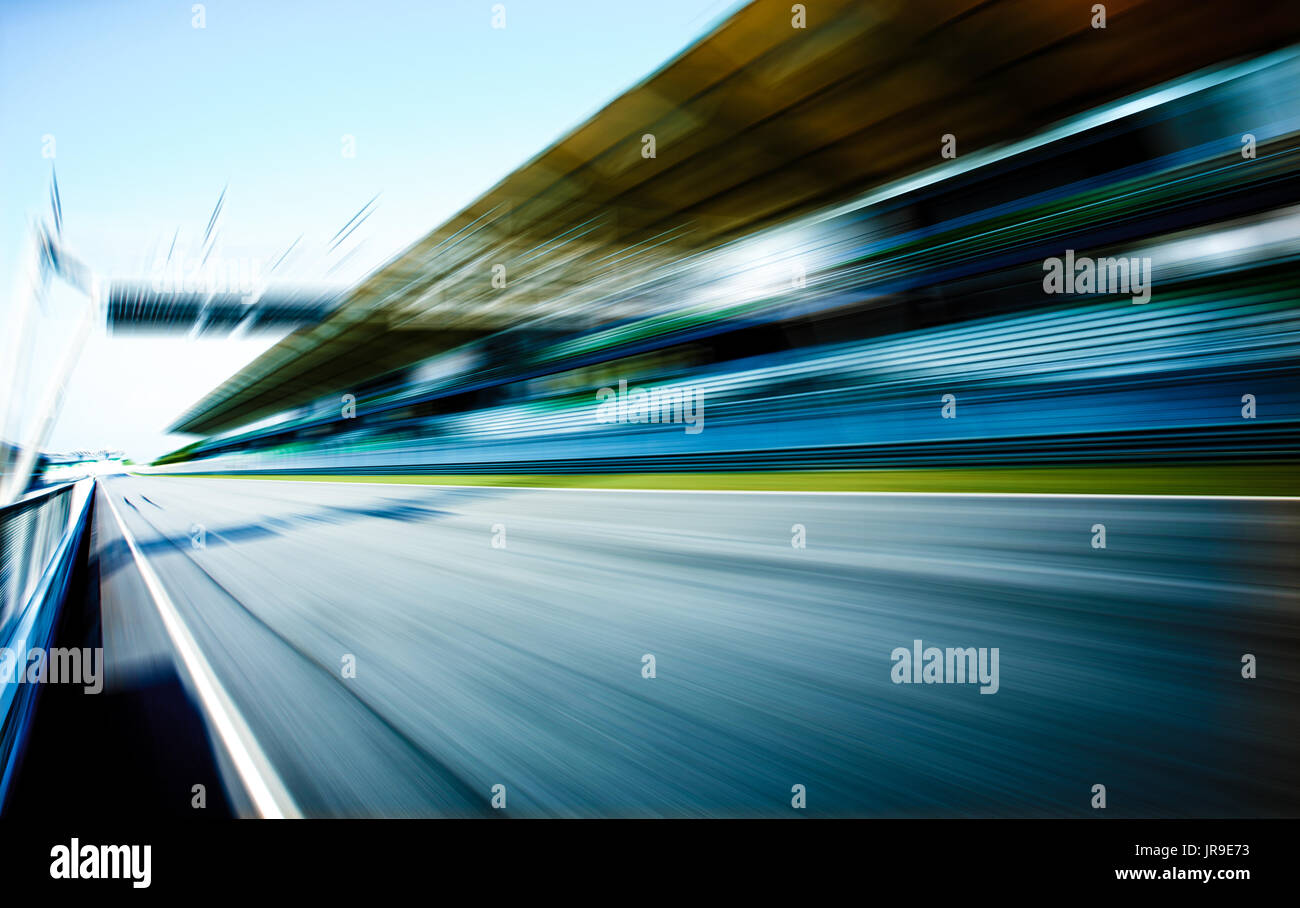 Racetrack in motion blur, racing sport background . Stock Photo