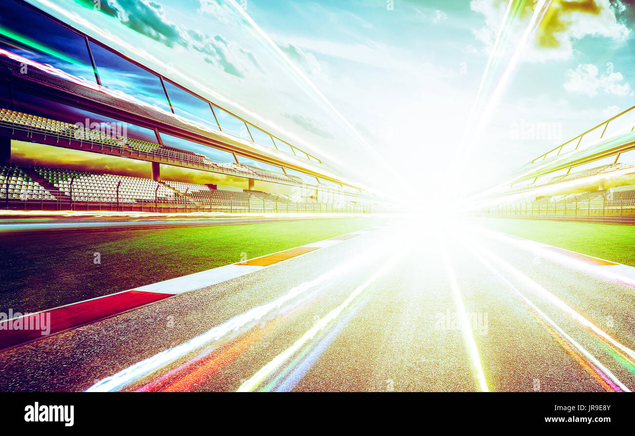 View of the infinity empty asphalt international race track  with light trail effect . evening scene . - Stock Image