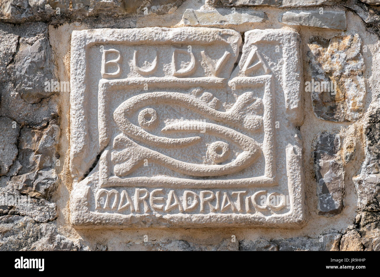 Historic symbol of Budva on wall of the ancient Citadel in the Old City of Budva in Montenegro. Stock Photo