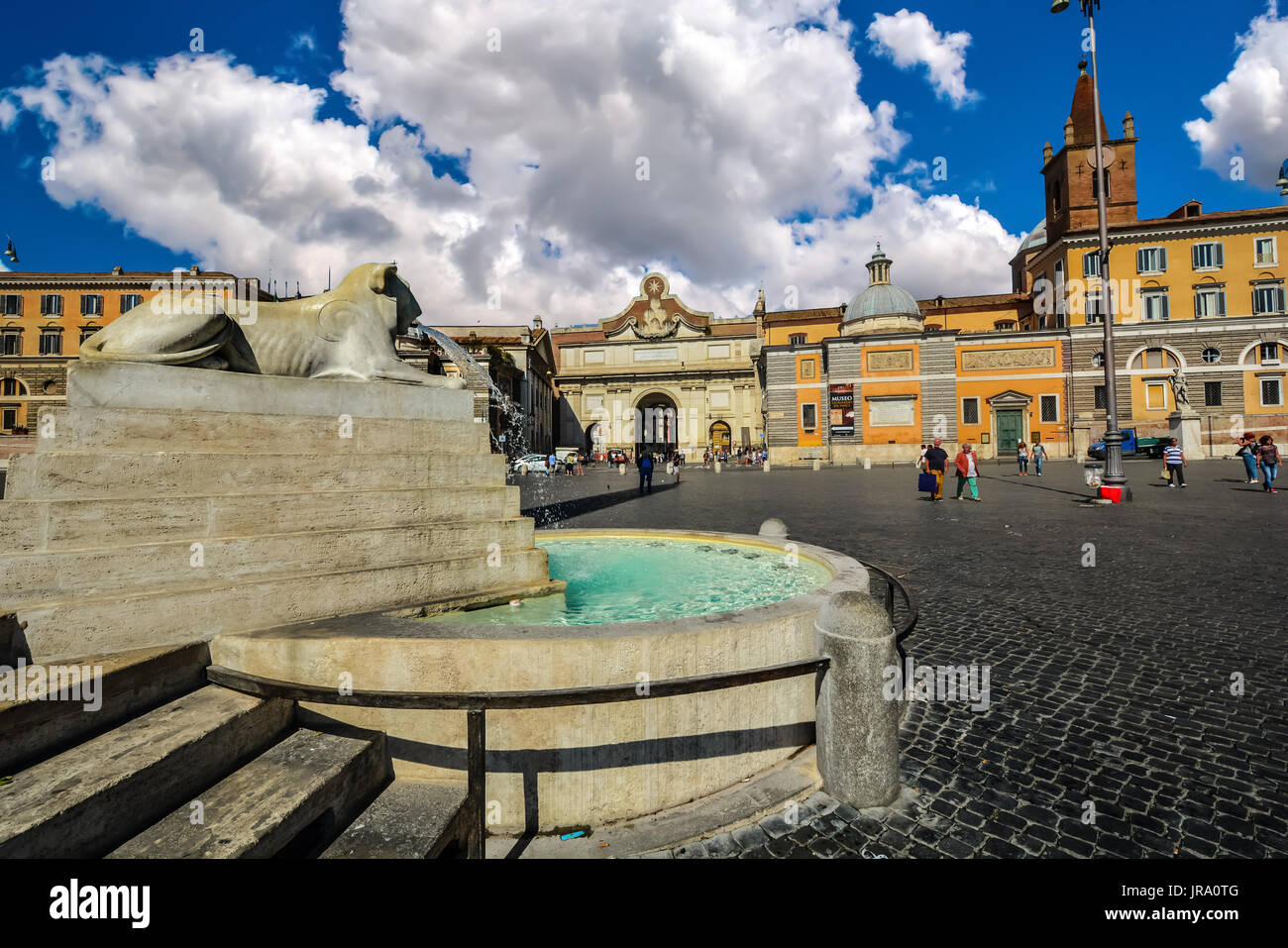 Lion fountain or Fontana Dei Leoni In Piazza Del Popolo on a sunny, partly cloudy day in Rome Italy - Stock Image