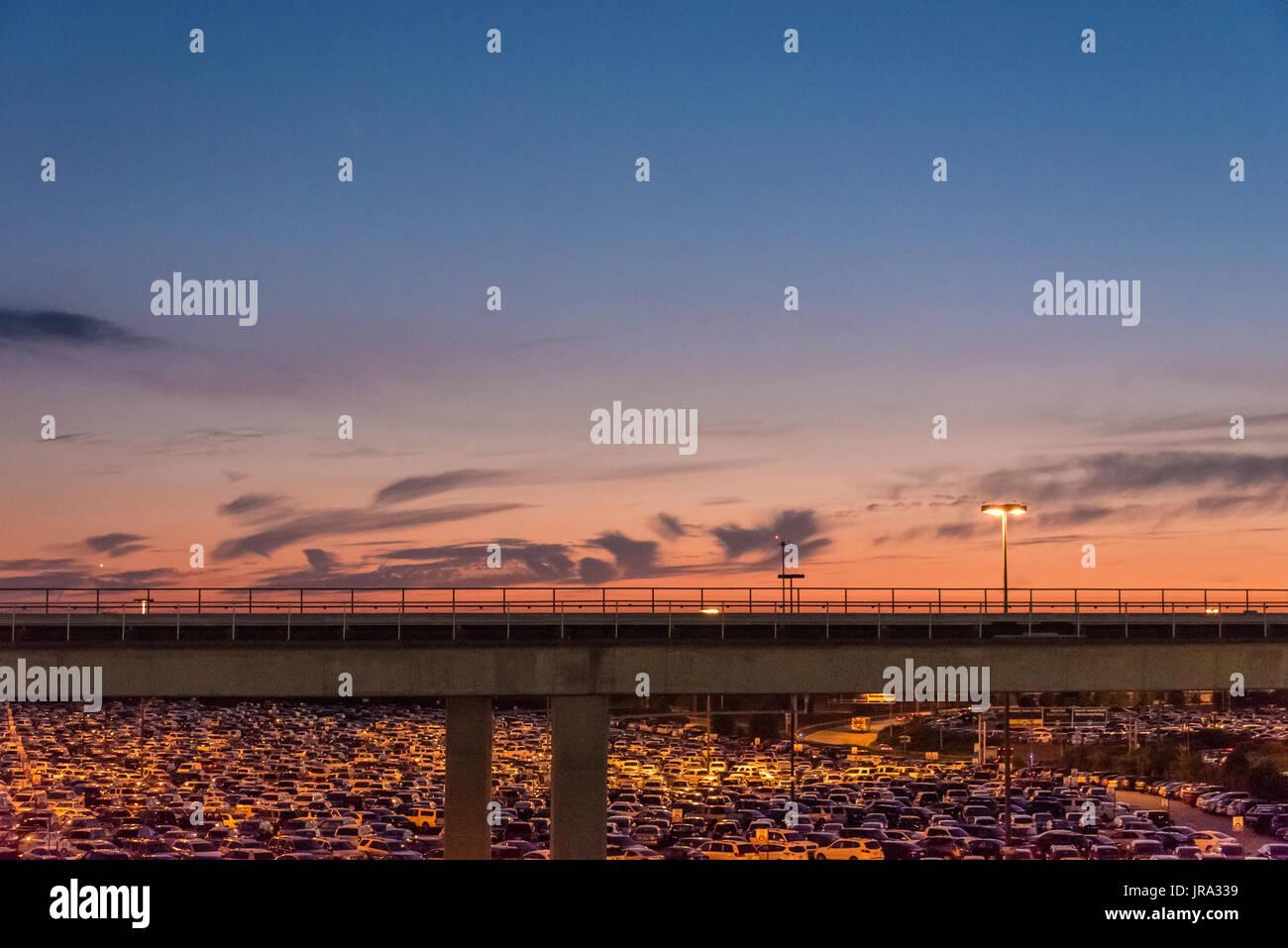 Dusk settles over a full parking lot at Hartsfield-Jackson Atlanta International Airport in Atlanta, Georgia. (USA) - Stock Image