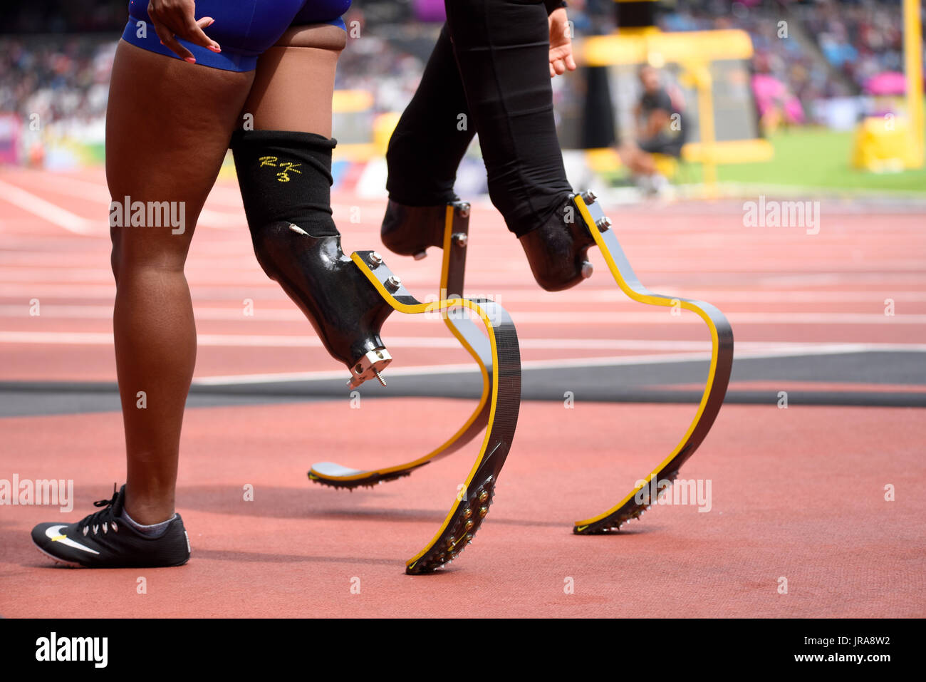 Running blades flex feet with spikes of runners competing in the T44 200m at the World Para Athletics Championships, London Stadium. Space for copy - Stock Image
