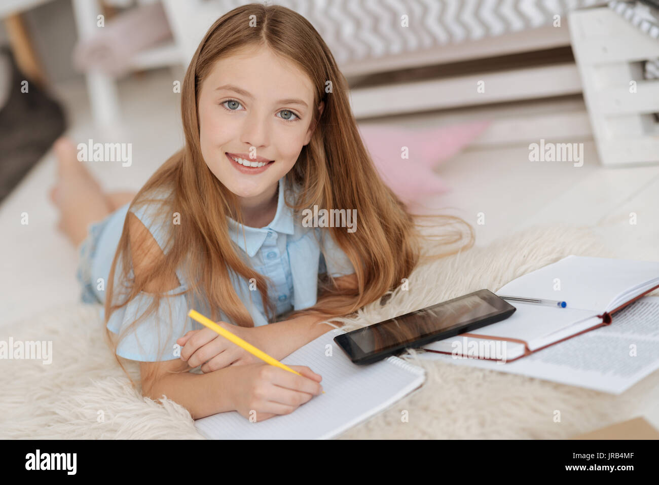 Girl of unearthly beauty smiling into camera - Stock Image