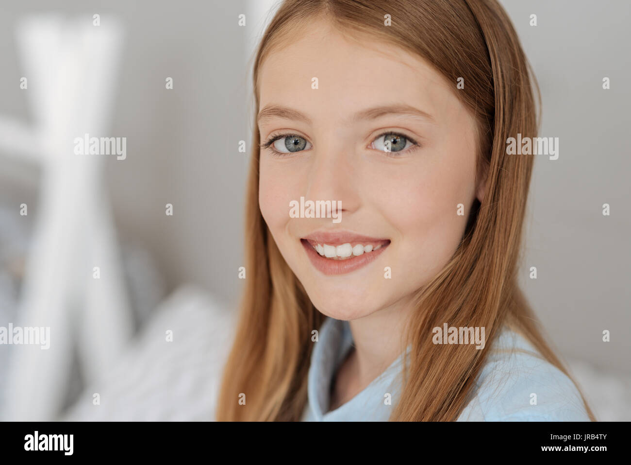 Portrait of beautiful grey eyed girl - Stock Image
