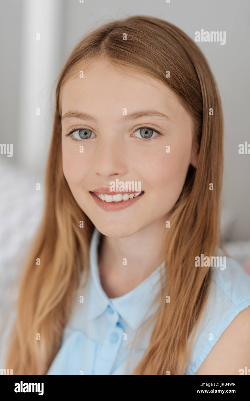 Pretty young lady smiling for camera - Stock Image
