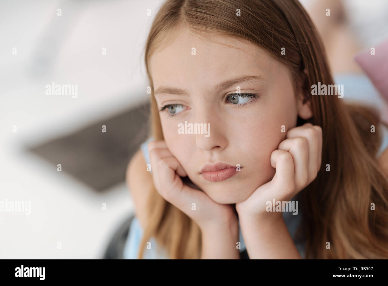 Upset female youngster looking into vacancy - Stock Image