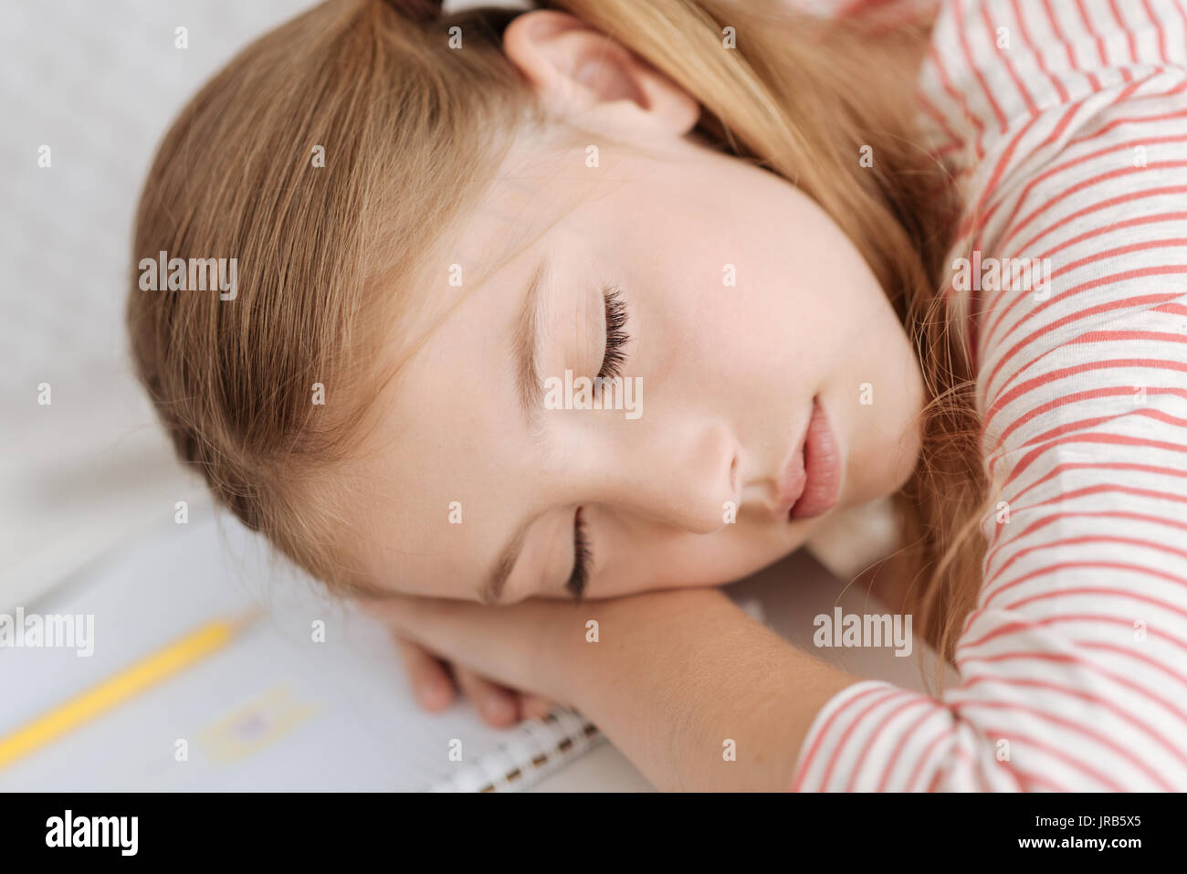 Close up of adorable girl having nap - Stock Image